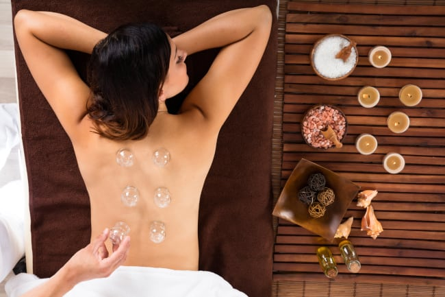 AA woman taking a nap while having a cupping therapy