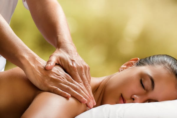 A masseur performing a massage therapy to a lady