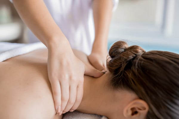 A woman having a Deep tissue massage therapy at the back of her neck