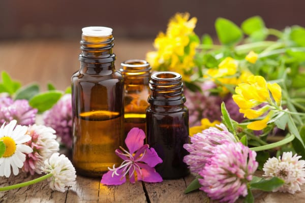 A table with a essential oil and a herbal flower
