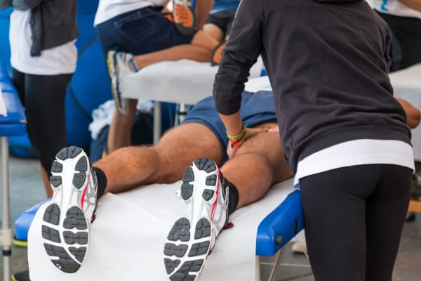 An athlete having a massage before the game starts