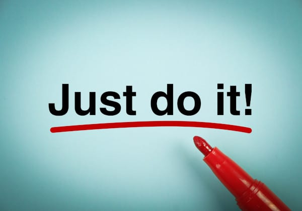 A sky blue paint and a red marker with a word JUST DO IT