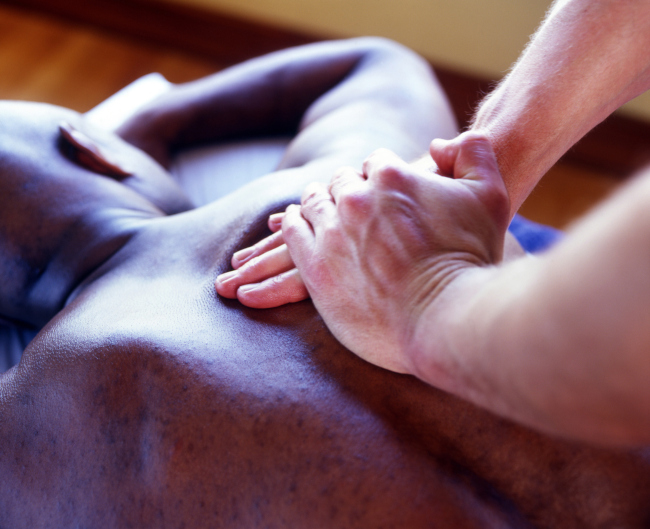 A masseur performing a massage therapy to an athlete