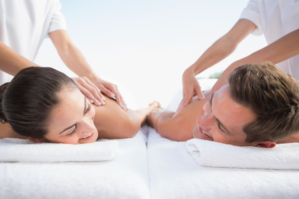 A man and a woman having their Couples massage