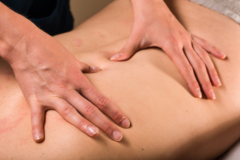 A person having a Deep tissue massage on his back