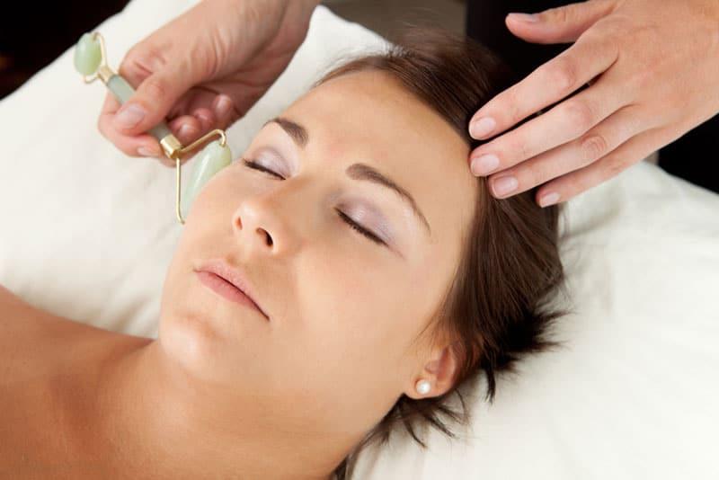 A woman having a stone facial massage