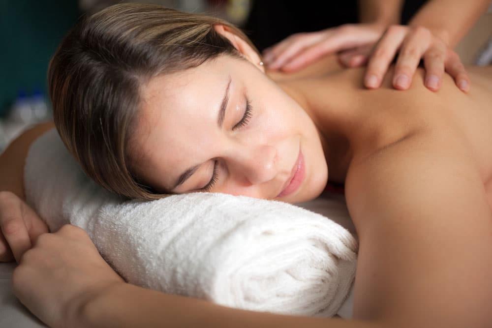 A woman laying and having Swedish massage