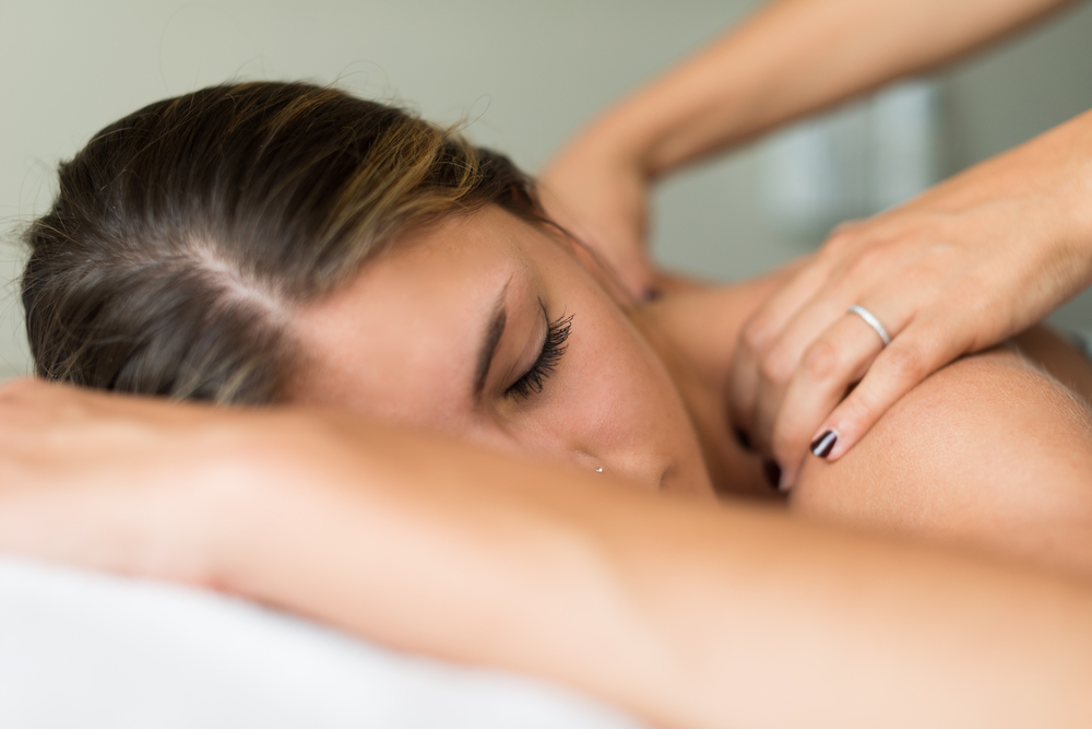 A woman having therapeutic massage therapy